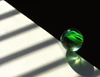 Istockgreenmarble_on_edge_of_table